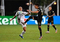 LAKE BUENA VISTA, FL - JULY 18: Rolf Feltscher #25 of LA Galaxy and Eduard Atuesta #20 of LAFC battle for the ball during a game between Los Angeles Galaxy and Los Angeles FC at ESPN Wide World of Sports on July 18, 2020 in Lake Buena Vista, Florida.