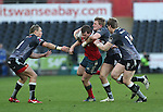 Munster centre Denis Hurley in need of support as Ospreys trio Hanno Dirksen, Ben John and Jonathan Spratt close in.<br /> Guiness Pro12<br /> Ospreys v Munster<br /> Liberty Stadium<br /> 07.03.15<br /> ©Steve Pope - SPORTINGWALES