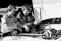 Neil Bonnet, right, looks at the engine of his race car,   Atlanta Journal 500, Atlanta Motor Speedway, Hampton, Georgia, November 6, 1983.  (Photo by Brian Cleary/www.bcpix.com)