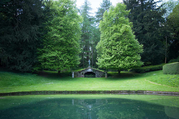 Looking over the Upper Pond to the Upper Cascade with statue of  Venus, Rousham House and Garden.