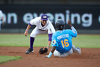 Winston-Salem Dash shortstop Laz Rivera (16) waits to apply a tag to Andruw Monasterio (16) of the Myrtle Beach Pelicans as he attempts to steal second base at BB&T Ballpark on August 6, 2018 in Winston-Salem, North Carolina. The Dash defeated the Pelicans 6-3. (Brian Westerholt/Four Seam Images)