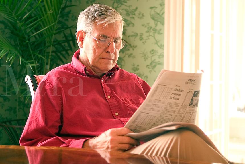Senior man reading the newspaper.