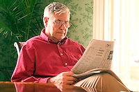 Senior man reading the newspaper.