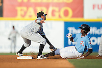 Eric Jenkins (5) of the Hickory Crawdads is tagged out at second base by Delmarva Shorebirds shortstop Ricardo Andujar (7) at L.P. Frans Stadium on June 18, 2016 in Hickory, North Carolina.  The Shorebirds defeated the Crawdads 4-2 in game two of a double-header.  (Brian Westerholt/Four Seam Images)