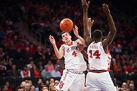 NEW YORK, NY - Sunday December 13, 2015: Federico Mussini (#4) of St. John's scrambles for the ball.  St. John's defeats Syracuse 84-72 during the NCAA men's basketball regular season at Madison Square Garden in New York City.