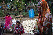 Rekha RAMESH (centre) is seen with her youngers sister and mother (right) in the backyard of her  house in Dhawati VIllage of Khaknar block of Burhanpur district in Madhya Pradesh, India.  Photo: Sanjit Das/Panos for ACF