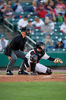 Rochester Red Wings catcher Wynston Sawyer (7) and home plate umpire Chris Graham await a pitch during a game against the Pawtucket Red Sox on May 19, 2018 at Frontier Field in Rochester, New York.  Rochester defeated Pawtucket 2-1.  (Mike Janes/Four Seam Images)