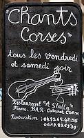 Europe/France/Corse/2B/Haute-Corse/Calvi: Restaurant A'Stalla, 13, rue G. Clemenceau détail ardoise signalant les chants corses