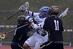 Dan Tempone (center) of Holmdel High School is sandwiched between Patrick Cleeland (left) and Vinnie Deck (right) both of Southern Regional as Holmdel takes on Southern Regional in a boys varsity lacrosse game held at Roggy Field at Holmdel High School in Holmdel on Thursday March 29, 2018.<br />  Mark R. Sullivan | For NJ Advance Media