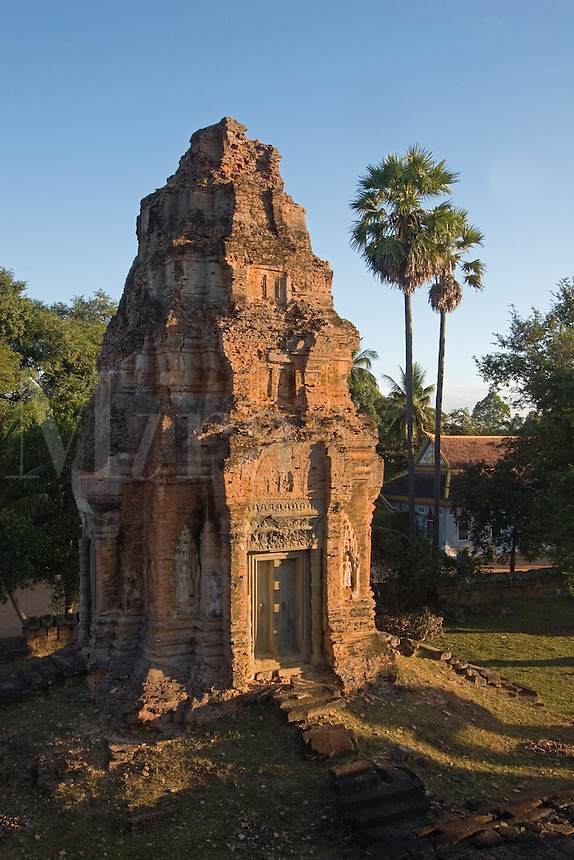 Sunrise on the west brick tower at Bakong, the 9th century state Hindu temple of Indravarman I in the Roluos District of Angkor Wat - Cambodia.........