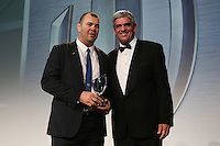 LONDON, ENGLAND - NOVEMBER 01:  Michael Cheika (L) the coach of Australia receives the World Rugby Coach of the Year award from Nick Mallett (R) during the World Rugby Awards 2015 at Battersea Evolution on November 1, 2015 in London, England.  (Photo: World Rugby)