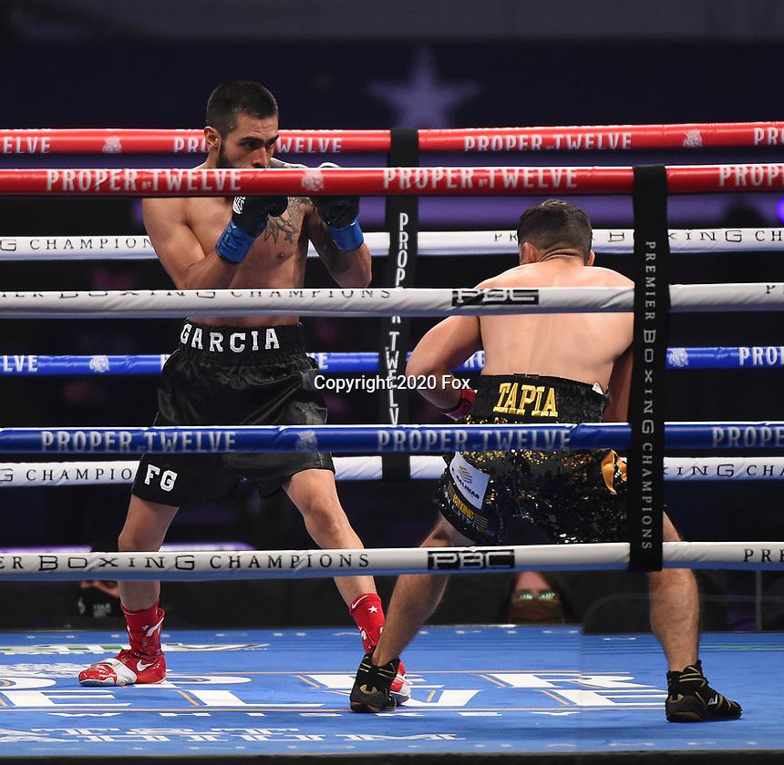 ARLINGTON, TX - DECEMBER 5: Juan Tapia and Fernando Garcia during their fight on Fox Sports PBC Pay-Per-View fight night at AT&T Stadium in Arlington, Texas on December 5, 2020. (Photo by Frank Micelotta/Fox Sports)