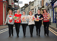 Pictured L-R: Local residents wearing Christmas jumpers Rhian Blackford, Kathryn Pyart, Del Bennett, Donna Bentley, Ruth Martin and Linda Adams-Lewis in Cardigan town centre<br /> Re: The town of Cardigan in west Wales will be temporarily renamed Jumper tomorrow (Thursday).