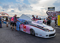 Aug 29, 2014; Clermont, IN, USA; Crew members unveil the new paint job of NHRA pro stock driver Rodger Brogdon during qualifying for the US Nationals at Lucas Oil Raceway. Mandatory Credit: Mark J. Rebilas-USA TODAY Sports