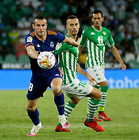 28th August 2021; Benito Villamarín Stadium, Seville, Spain, Spanish La Liga Football, Real Betis versus Real Madrid; Real Madrid player Gareth Bale breaks away from Betis player Canales on the ball