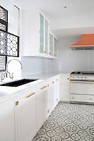 Kitchen with white cupboards