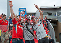 22 May 2010: Toronto FC fans show their colours and support during a game between the New England Revolution and Toronto FC at BMO Field in Toronto..Toronto FC won 1-0.....