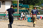 Emts running to victims hurt on a beach