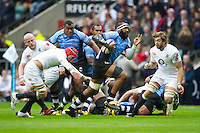Api Naikatini of the Flying Fijians charges past Tom Johnson of England during the QBE International between England and Fiji at Twickenham on Saturday 10th November 2012 (Photo by Rob Munro)