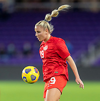 ORLANDO, FL - FEBRUARY 21: Adriana Leon #19 of Canada controls the ball during a game between Canada and Argentina at Exploria Stadium on February 21, 2021 in Orlando, Florida.