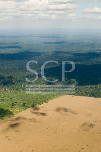 Pará State, Brazil. Aerial view of rain forest with newly cleared land and older cattle pasture.