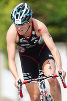 01 SEP 2013 - SARTROUVILLE, FRA - Great Britain's Vicky Holland, racing for Triathlon Ardennes, shows signs of an early fall as she climbs a hill on the bike during the women's Grand Prix de Triathlon de Sartrouville in Sartrouville, France (PHOTO COPYRIGHT © 2013 NIGEL FARROW, ALL RIGHTS RESERVED)