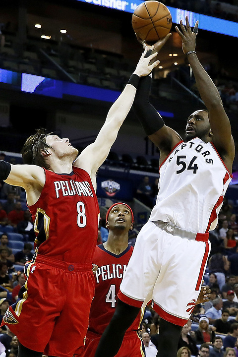 NEW ORLEANS, LA - MARCH 26: Patrick Patterson #54 of the Toronto Raptors shoots over Luke Babbitt #8 of the New Orleans Pelicans during the second half of a game at the Smoothie King Center on March 26, 2016 in New Orleans, Louisiana. The Raptors won 115-91. NOTE TO USER: User expressly acknowledges and agrees that, by downloading and or using this photograph, User is consenting to the terms and conditions of the Getty Images License Agreement.  (Photo by Jonathan Bachman/Getty Images) *** Local Caption *** Patrick Patterson; Luke Babbitt
