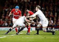 Photo: Richard Lane/Richard Lane Photography. Wales v England. RBS 6 Nations Championship. 16/03/2013. Wales' Sam Warburton is tackled by England's Joe Launchbury (rt).