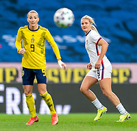 SOLNA, SWEDEN - APRIL 10: Lindsey Horan #9 of the USWNT looks to the ball during a game between Sweden and USWNT at Friends Arena on April 10, 2021 in Solna, Sweden.