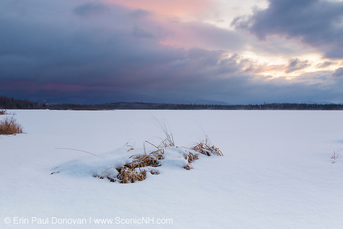 Pondicherry Wildlife Refuge - Sunrise from Cherry Pond during stormy weather (snow storm) in Jefferson, New Hampshire USA during the winter months.