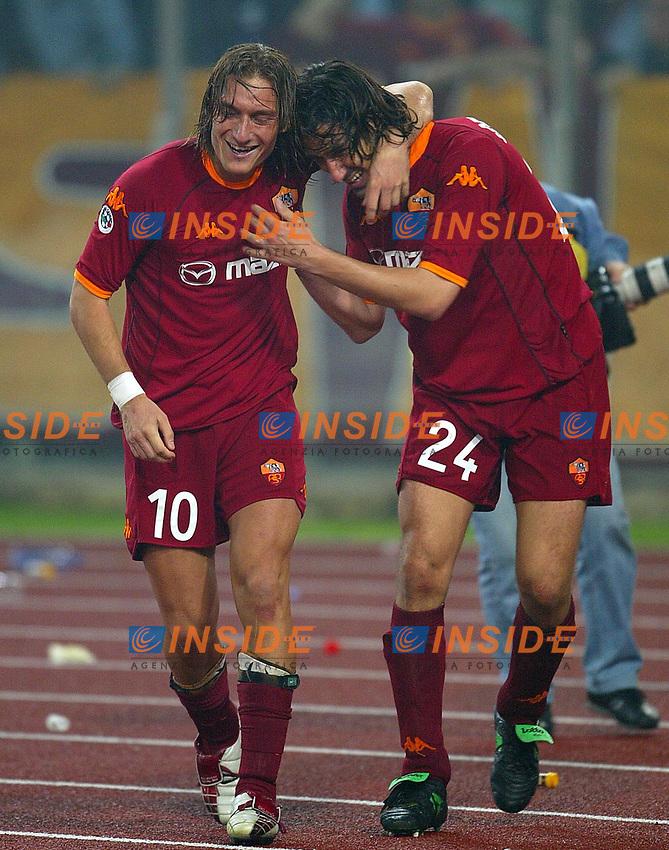 2002 October 27 <br /> Lazio - Roma 2-2<br /> <br /> Francesco Totti abbraccia Marco Delvecchio dopo il gol del pareggio