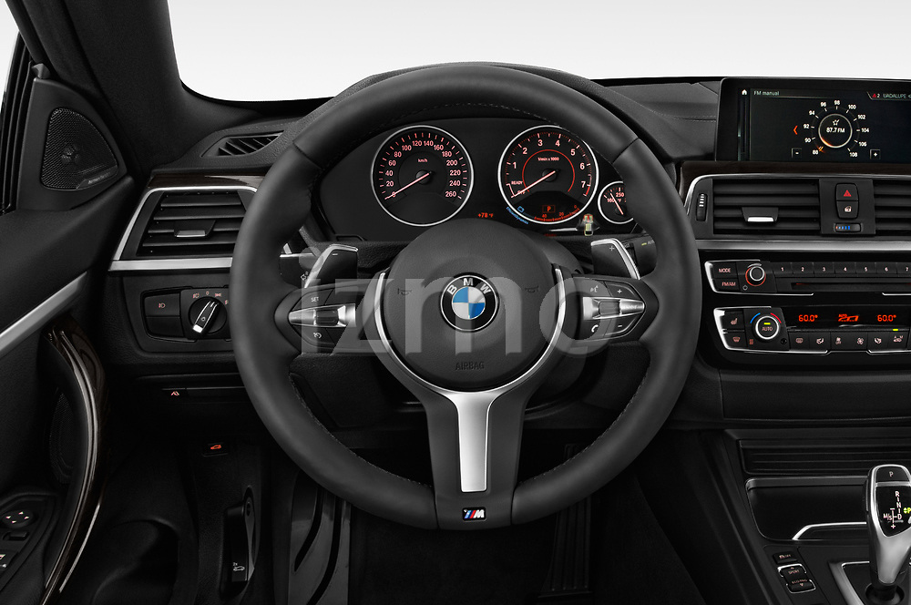 Car pictures of steering wheel view of a 2019 BMW 4 series M Sport 2 Door Coupe