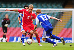 David Edwards takes on Martin Buchel. Wales V Liechtenstein, 2010 World Cup Qualifying Group 4 © Ian Cook IJC Photography iancook@ijcphotography.co.uk www.ijcphotography.co.uk