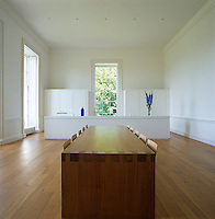 When not in use, the kitchen utilities virtually disappear in this spacious kitchen/dining room with a limed-oak table