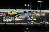 Jul. 2, 2011; Daytona Beach, FL, USA; NASCAR Sprint Cup Series drivers Mark Martin (5), Martin Truex Jr (56), Kurt Busch (22), Clint Bowyer (33), Joe Nemechek (87), Landon Cassill (51), Regan Smith (78), Tony Stewart (14) and Brian Vickers (83) crash as Dale Earnhardt Jr (88) goes low to avoid during the Coke Zero 400 at Daytona International Speedway. Mandatory Credit: Mark J. Rebilas-