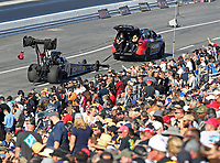 Nov 16, 2019; Pomona, CA, USA; The dragster of NHRA top fuel driver Leah Pritchett is towed in front of the crowd during qualifying for the Auto Club Finals at Auto Club Raceway at Pomona. Mandatory Credit: Mark J. Rebilas-USA TODAY Sports