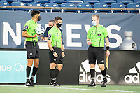 FOXBOROUGH, MA - SEPTEMBER 04: Match officials referee Kenneth Rojas and Assistants Justin Lopez and Ian Mangione on the pitch before the game during a game between Forward Madison FC and New England Revolution II at Gillette Stadium on September 04, 2020 in Foxborough, Massachusetts.