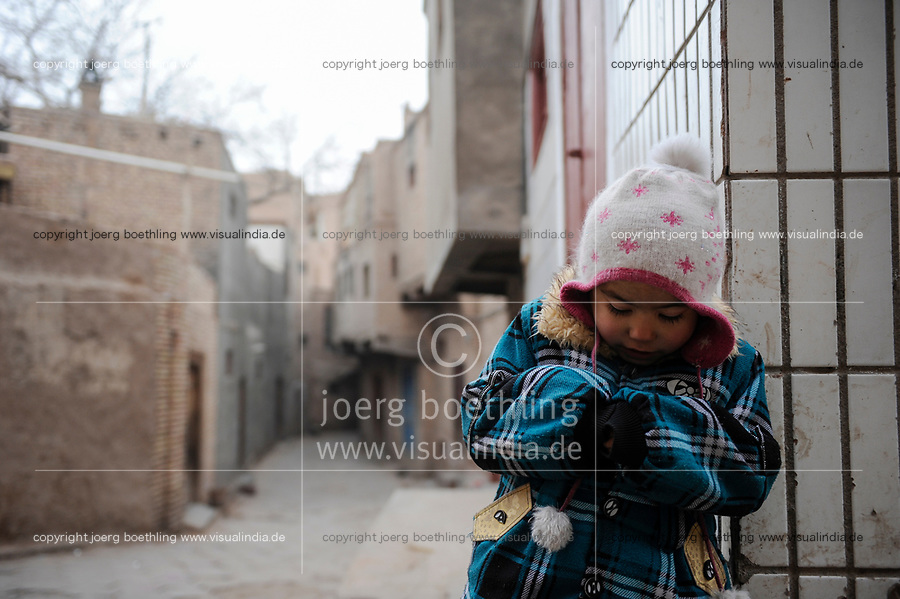 CHINA, autonomous province Xinjiang, city Kashgar where uyghur turkic people are living, gentrification, demolition of parts of the historic oldtown and construction of new buildings for migrated han chinese  / CHINA, autonome Provinz Xinjiang, Stadt Kashgar , hier lebt das Turkvolk der Uiguren , Gentrifizierung, Abriss der uigurischen Altstadt und Neubau von Wohnblocks, durch Zuwanderung von Han Chinesen sinkt der uigurische Bevoelkerungsanteil