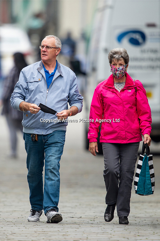 Pictured: A man and women walk down Oxford Street, Swansea city centre, Wales, UK. Monday 28 September 2020<br /> Re: Local lockdown will be in force from 6pm on the 27th September 2020 due to the Covid-19 Coronavirus pandemic, in Swansea, Wales, UK.