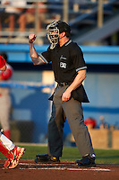 Home plate umpire Tim Hromada makes a call during a NY-Penn League game between the Batavia Muckdogs and Williamsport Crosscutters at Dwyer Stadium on August 25, 2012 in Batavia, New York.  Batavia defeated Williamsport 6-5.  (Mike Janes/Four Seam Images)