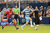 KANSAS CITY, KS - JULY 31: Graham Zusi #8 Sporting KC with the ball during a game between FC Dallas and Sporting Kansas City at Children's Mercy Park on July 31, 2021 in Kansas City, Kansas.