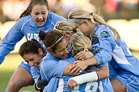 North Carolina Tar Heels forward Casey Nogueira (54) (middle facing) celebrates scoring the game winning goal with teammates. The North Carolina Tar Heels defeated the Notre Dame Fighting Irish 2-1 during the finals of the NCAA Women's College Cup at Wakemed Soccer Park in Cary, NC, on December 7, 2008. Photo by Howard C. Smith/isiphotos.com