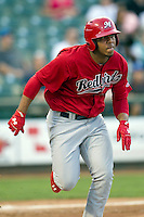 Memphis Redbirds outfielder Oscar Taveras #15 runs to first base during the Pacific Coast League baseball game against the Round Rock Express on April 24, 2014 at the Dell Diamond in Round Rock, Texas. The Express defeated the Redbirds 6-2. (Andrew Woolley/Four Seam Images)