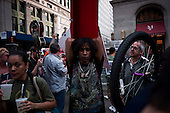 """New York, New York<br /> October 10, 2011<br /> <br /> """"Occupy Wall Street"""" protesters encampment at Zuccotti Park overflows on to adjacent streets as more  people come to take part or view the site.<br /> <br /> The participants of the event, that began on September 17, are mainly protesting against social and economic inequality, corporate greed, and the influence of corporate money and lobbyists on government, among other concerns."""