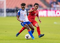 HOUSTON, TX - FEBRUARY 3: Melchie Dumonay #6 of Haiti is defended by Marta Cox #11 of Panama during a game between Panama and Haiti at BBVA Stadium on February 3, 2020 in Houston, Texas.