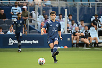 KANSAS CITY, KS - AUGUST 10: Kaveh Rad #48 Sporting KC with the ball during a game between Club Leon and Sporting Kansas City at Children's Mercy Park on August 10, 2021 in Kansas City, Kansas.