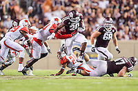 Texas A&M running back James White (20)  rushes past Lamar defenders during NCAA Football game, Saturday, September 06, 2014 in College Station, Tex. Texas A M defeated Lamar 73-3. (Mo Khursheed/TFV Media via AP Images)