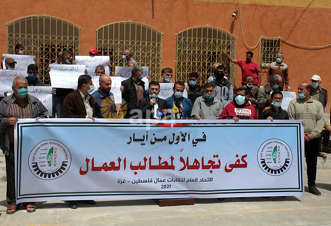 Palestinians take part in a protest marking International Workers' Day, in front of the Palestine General Federation of Trade Unions, in Gaza City, on April 29, 2021. The unemployment rate in Palestine increased in 2020 to reach about 26% of the labor force participants compared with about 25% in 2019. Whereas the number of unemployed persons decreased to 334,000 unemployed persons in 2020 compared to 344,000 unemployed persons in 2019. Photo by Mahmoud Ajjour