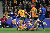 13th July 2021; AAMI Park, Melbourne, Victoria, Australia; International test rugby, Australia versus France; Baptiste Couilloud of France passes the ball under pressure from Banks (Aus)