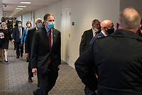 United States Senator Richard Blumenthal (Democrat of Connecticut) and other Senators evacuate to a safe place in the Dirksen Senate Office Building after Electoral votes being counted during a joint session of the United States Congress to certify the results of the 2020 presidential election in the US House of Representatives Chamber in the US Capitol in Washington, DC on Wednesday, January 6, 2021, as interrupted as thousands of pr-Trump protestors stormed the U.S. Capitol and the House chambers.  .<br /> Credit: Rod Lamkey / CNP/AdMedia